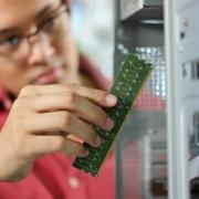 Boy Fixing Computer